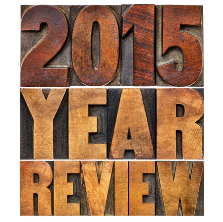 summary: 2015 review banner - annual review or summary of the recent year - isolated word abstract in letterpress wood type blocks
