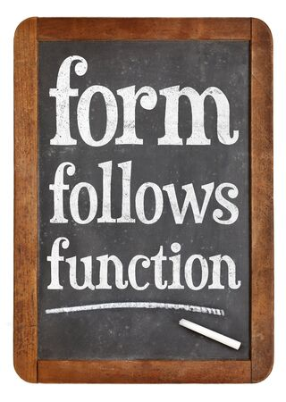 form follows function design principle - white chalk text on a vintage slate blackboard Фото со стока