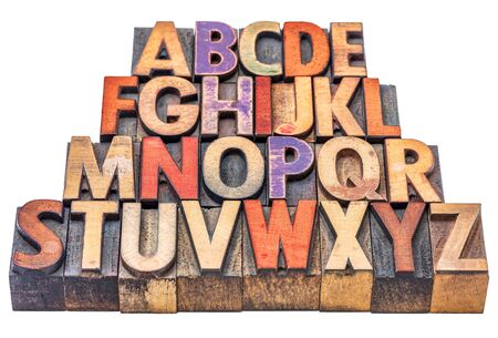 abecedario: Alfabeto en tipo de madera de tipograf�a manchado por las tintas de color, aislado en blanco Foto de archivo