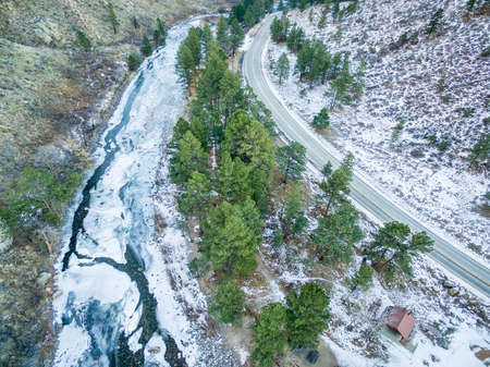 aerial view of Cache la Poudre River at DIamond Rock west of  Fort Collins in northern Colorado - winter scenery with a partially frozen river and colorado highway 14