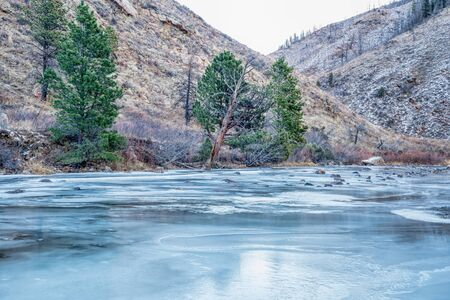 fort collins: Cache la Poudre River at Diamond Rock west of  Fort Collins in northern Colorado - winter scenery with a partially frozen river