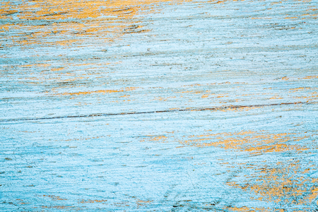 painted blue and scratched wood texture background - old cutting board