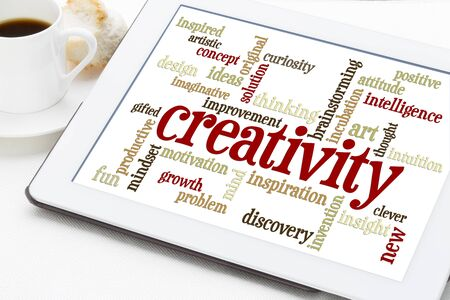 creativity: creativity concept - a word cloud on a  digital tablet with a cup of coffee