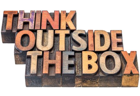 wood type: think outside the box - motivational phrase in vintage letterpress wood type, stained by ink, isolated on white