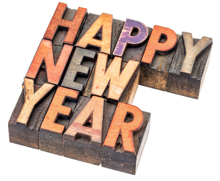 wood type: Happy New Year greeting card - isolated word abstract in vintage letterpress wood type blocks with ink patina