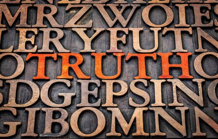 wood type: truth word abstract in wood type printing blocks stained by red ink Stock Photo