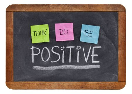 positivity: think, do, be positive - positivity concept, color sticky notes, white chalk and handwriting on a vintage slate blackboard