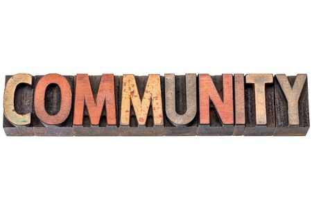 community banner - isolated word abstract in vintage letterpress wood type stained by inks