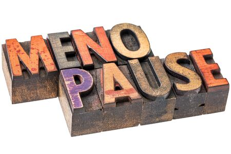 MENOPAUSE: menopause word abstract  - isolated text in vintage wood letterpress printing blocks stained by color inks Stock Photo
