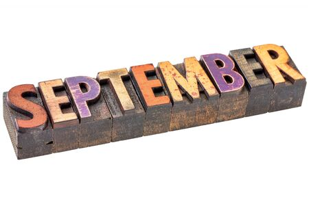 wood type: September  banner - isolated word in vintage letterpress wood type - calendar concept