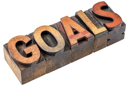 setting goals: goals word abstract - an isolated banner in vintage letterpress wood type blocks stained by color inks Stock Photo