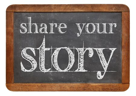 Share your story sign - white chalk text on a vintage slate blackboard isolated on white