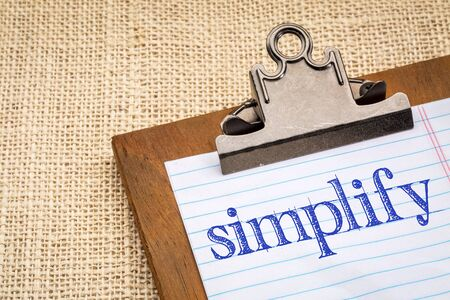 simplify concept, advice or reminder - a word on a clipboard