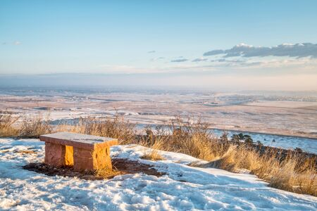 collins: sandstone bench in Colorado foothills overlooking Fort Collins and prairie, winter scenery