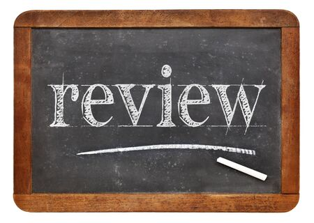 critique: review word in white chalk on a vintage slate blackboard Stock Photo