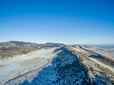 fort collins: aerial view of hogbacks (ridges) typical for foothills of Rocky Mountains along Front Range, winter scenery near Fort Collins in northern Colorado