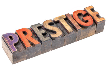 prestige: prestige word abstract - an isolated banner in vintage letterpress wood type blocks stained by color inks Stock Photo
