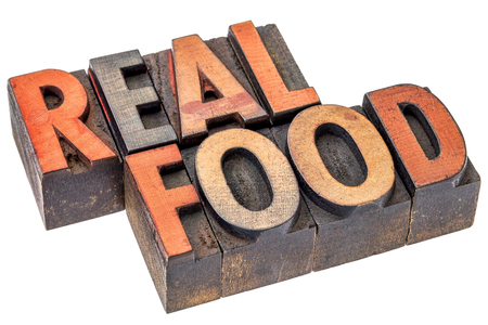 unprocessed: real food word abstract - isolated text in vintage letterpress wood type printing blocks - healthy eating and lifestyle concept