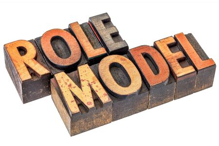 role: role model -  leadership concept - isolated word abstract in letterpress  wood type stained by color inks Stock Photo