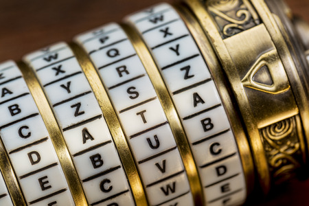 secret code: data word as a password to combination puzzle box with rings of letters Stock Photo
