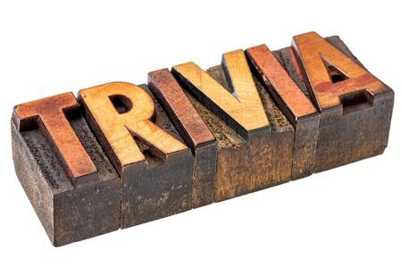 trivia: trivia - isolated word in vintage letterpress wood type stained by inks  - pop culture concept