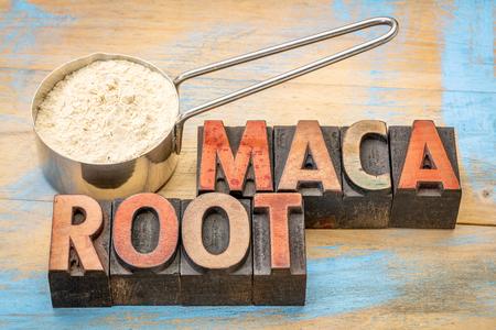 maca root: maca root powder on a metal measuring scoop against painted wood and words in vintage letterpress wood type