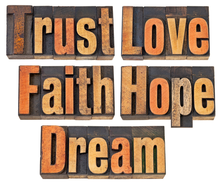 letterpress words: trust, love, faith, hope and dream - a collage of isolated words in vintage letterpress wood type