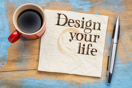self development: Design your life advice or suggestion  on a napkin with a cup of coffee