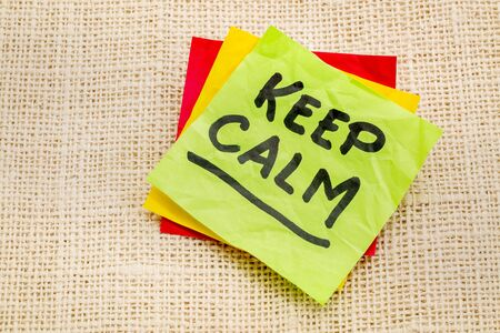 morale: Keep calm reminder or advice on a sticky note against burlap canvas