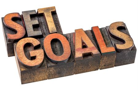 set goal: set goal word abstract  - an isolated banner in vintage letterpress wood type stained by color inks Stock Photo