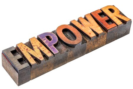 empower: empower word abstract  - an isolated motivational banner in vintage letterpress wood type stained by color inks