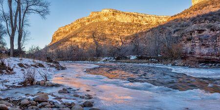 cache la poudre river: winter sunset over Cache la Poudre River and Belvue Dome near Fort Collins, Colorado