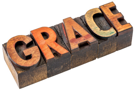grace word abstract  - an isolated banner in vintage letterpress wood type stained by color inks