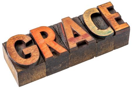 parola astratta la grazia - un banner isolato in legno di tipo vintage tipografica macchiata da inchiostri a colori