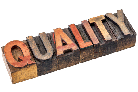 quality word abstract  - an isolated banner in vintage letterpress wood type stained by color inks