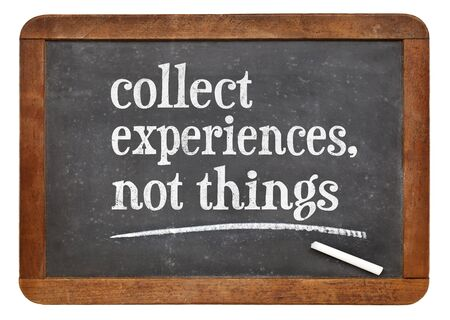 juntar: Collect experience, not things - inspirational advice or reminder  on a vintage slate blackboard