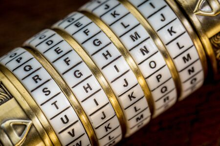 secret code: think word as a password to combination puzzle box with rings of letters Stock Photo