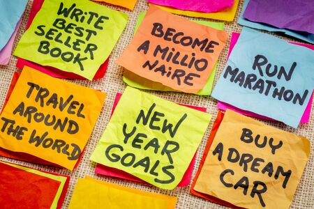 unrealistic: become a millionaire and unrealistic new year goals or resolutions - colorful sticky notes on canvas