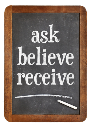 Ask, believe, receive - spiritual words on a vintage slate blackboard
