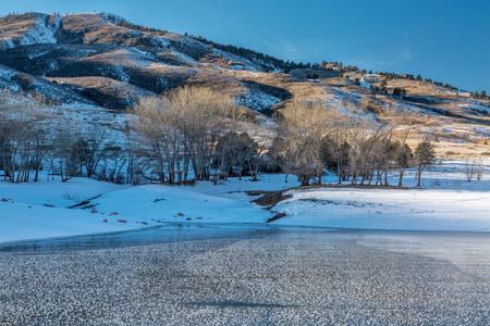 horsetooth reservoir: frozen Horsetooth Reservoir and Lory State Park at winter sunset, Fort COllins, COlorado