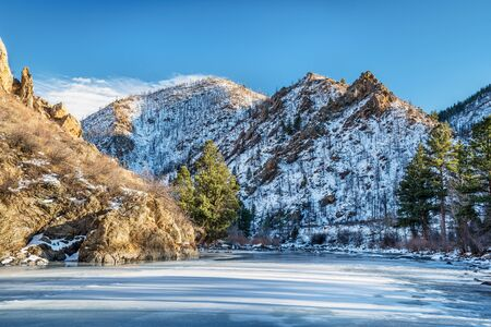 cache la poudre: Canyon of Cache la Poudre River in northern Colorado west of Fort Collins, winter scenery with snow and long shadows Stock Photo