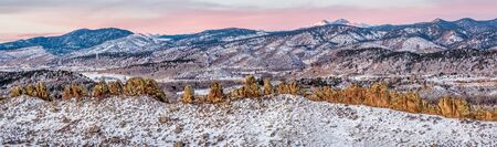 loveland: Panorama of Devils Backbone and Longs Peak at sunrise in winter scenery, Loveland in northern Colorado Stock Photo