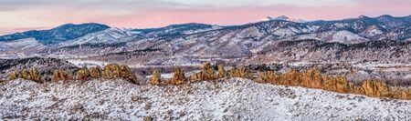 longs peak: Panorama of Devils Backbone and Longs Peak at sunrise in winter scenery, Loveland in northern Colorado Stock Photo
