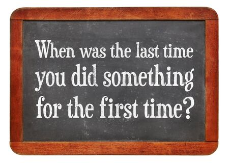 When was last time you did something for the first time? A question on a vintage slate blackboard Reklamní fotografie