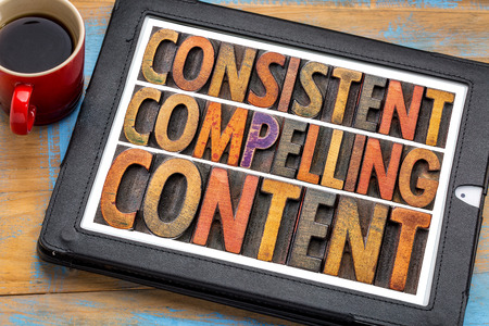 consistent, compelling content -  recommendation for bloging and social media marketing - a word abstract in vintage letterpress wood type on a digital tablet with a cup of coffee