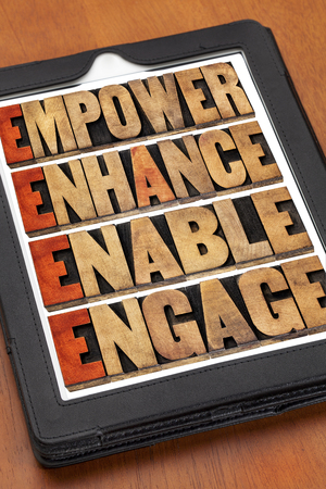 enable: empower, enhance, enable and engage - motivational leadership and business concept - a collage of iords in letterpress wood type on a digital tablet Stock Photo