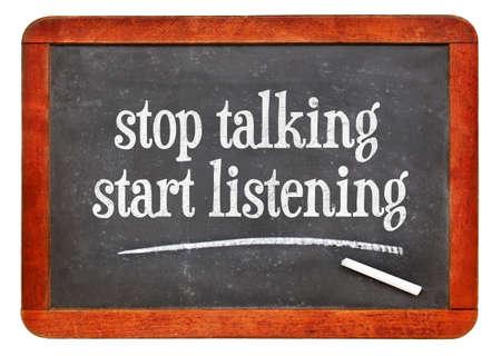 Stop talking, start listening - advice or reminder on a vintage slate blackboard
