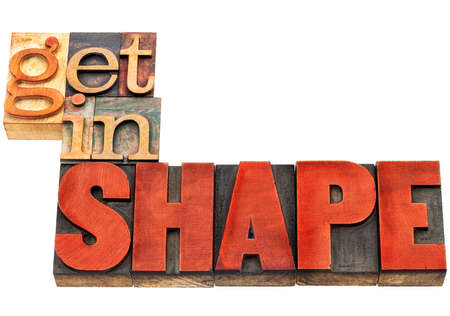 get in shape: get in shape motivation banner  - fitness concept - isolated text  in vintage letterpress wood type stained by red ink Stock Photo