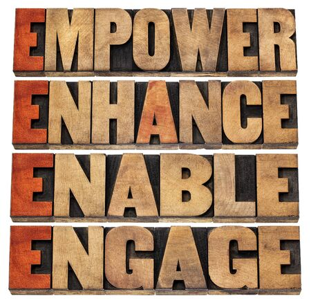 letterpress words: empower, enhance, enable and engage - motivational leadership and business concept - a collage of isolated words in letterpress wood type stained by red ink Stock Photo