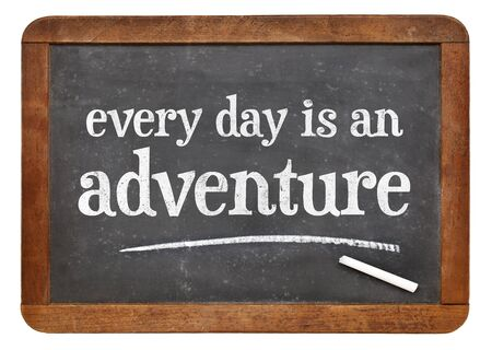 every: Every day is an adventure - positive attitude words on a vintage slate blackboard